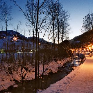 Winter circular trail along the Simme river in Zweisimmen with snow and lighting
